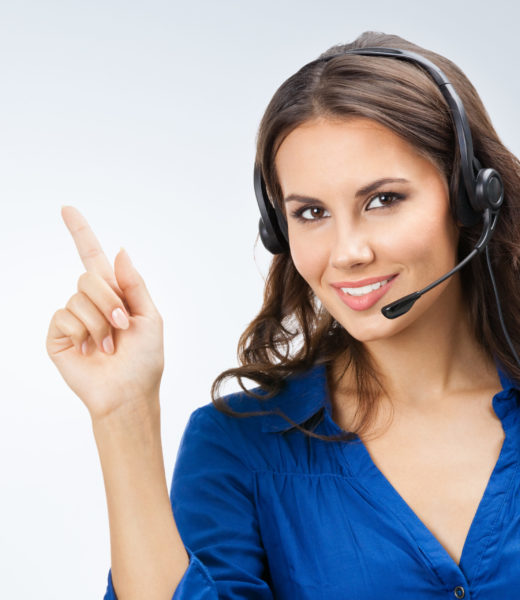 Portrait of happy smiling cheerful beautiful young support phone operator showing
