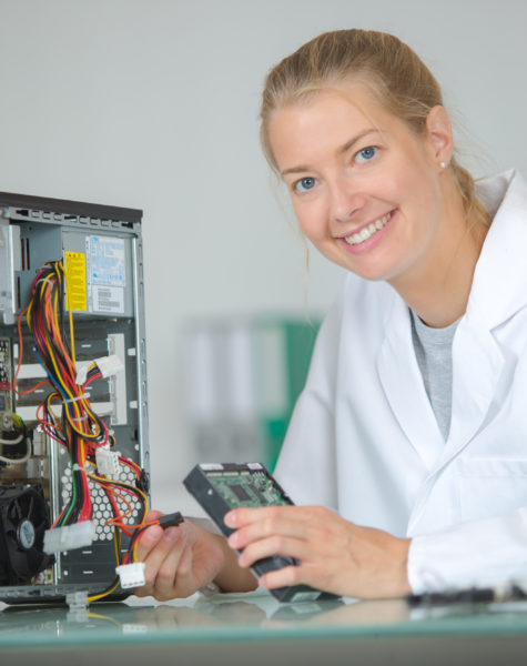 Female technician working on computer